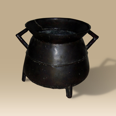 A 16th/17th Century bronze cauldron raised on three cast legs