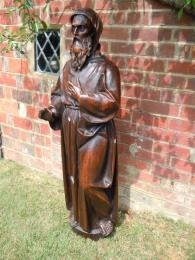 A 16th/17th Century Oak Statue Of St. Francis