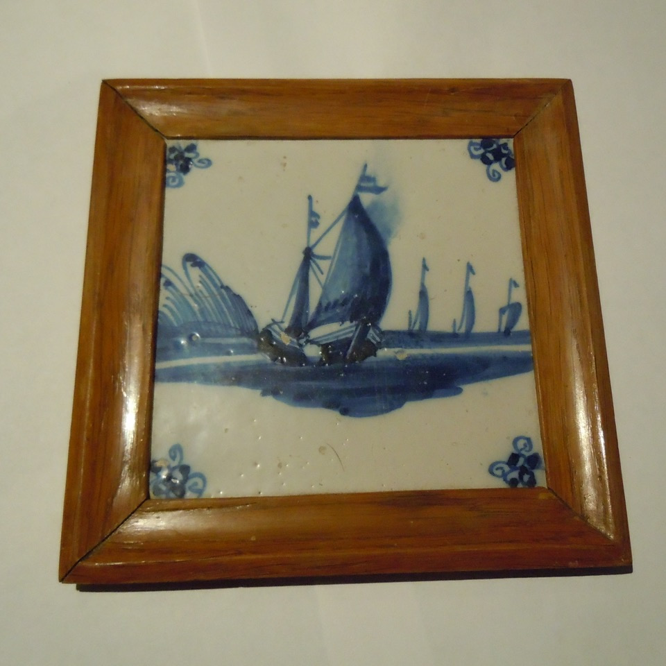 A 17th Century Blue & White Delft Tile Later Mounted