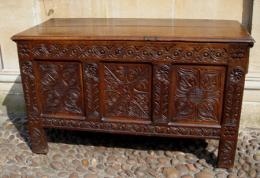 A 17th Century Carved Three Panel Oak Coffer