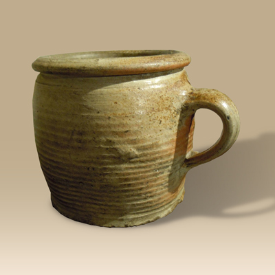 A 17th Century Hand Thrown Glazed Stoneware Mug