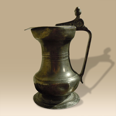 A 17th Century Pewter Jug With Lid