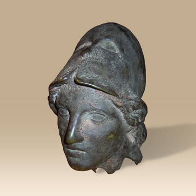 A Bronze Head Of Athena With A Corinthian Helmet.