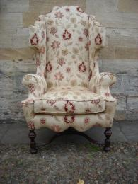 A Late 19th Century William & Mary Style High Wing Back Armchair