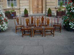 A Mid 18th Century Harlequin Set Of Seven Oak Chairs