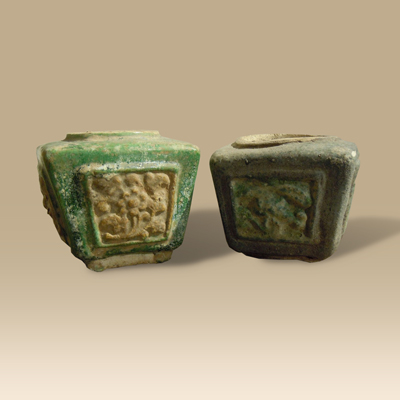 A Pair Of Ming Green Glazed Storage Vessels dating From The Mid 15th century