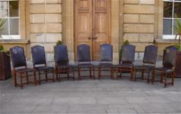 A True Set Of 8 Early 19th Century Walnut Chairs