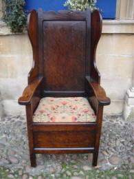 A Winged Chair Sometimes Known As A Lambing Chair Dating To The Late 18th Century