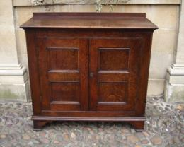 An 18th Century Oak Two Door Cupboard.