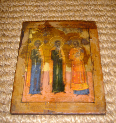 Painted Icon Depicting Three Saints And The Head Of Jesus